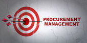 Finance concept: target and Procurement Management on wall background — Stock Photo