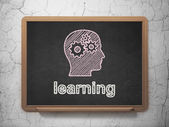 Education concept: Head With Gears and Learning on chalkboard background — Stock Photo