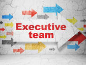 Business concept: arrow with Executive Team on grunge wall background — Zdjęcie stockowe