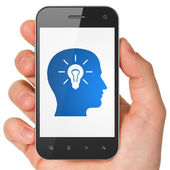 Finance concept: Head With Light Bulb on smartphone — Foto Stock