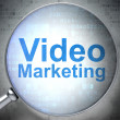 Business concept: Video Marketing with optical glass — Stock fotografie