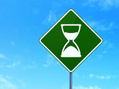 Timeline concept: Hourglass on road sign background — Stock Photo
