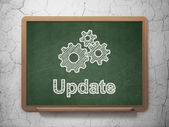 Web development concept: Gears and Update on chalkboard background — Stock Photo
