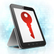 Privacy concept: Key on tablet pc computer — Stock Photo