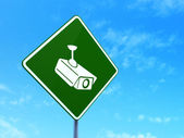 Protection concept: Cctv Camera on road sign background — Stock Photo