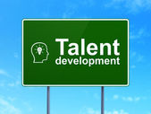 Education concept: Talent Development and Head With Lightbulb on road sign background — Stock Photo