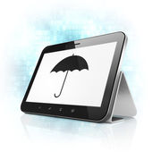 Safety concept: Umbrella on tablet pc computer — Stock Photo