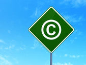 Law concept: Copyright on road sign background — Stock Photo