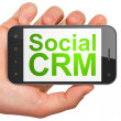 Finance concept: Social CRM on smartphone — Stock Photo