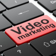 Finance concept: Video Marketing on computer keyboard background — Stock fotografie