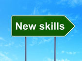 Education concept: New Skills on road sign background — Stock Photo