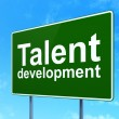 Постер, плакат: Education concept: Talent Development on road sign background