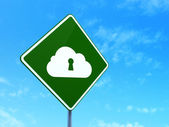 Cloud networking concept: Cloud With Keyhole on road sign background — Stok fotoğraf