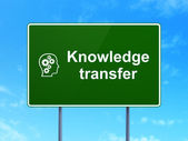 Education concept: Knowledge Transfer and Head With Gears on road sign background — Stock Photo