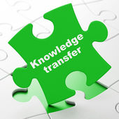 Education concept: Knowledge Transfer on puzzle background — Foto de Stock
