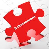 Education concept: Achievement on puzzle background — Stok fotoğraf