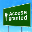 Stock Photo: Protection concept: Access Granted and Key on road sign background