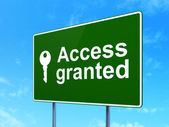 Protection concept: Access Granted and Key on road sign background — Stock Photo