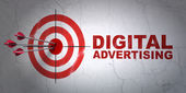 Marketing concept: target and Digital Advertising on wall background — Stock Photo