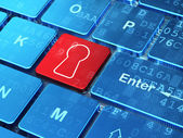 Protection concept: Keyhole on computer keyboard background — Stock Photo