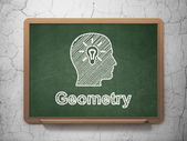 Education concept: Head With Light Bulb and Geometry on chalkboard background — Stock Photo