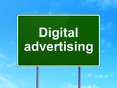 Marketing concept: Digital Advertising on road sign background — Stock Photo