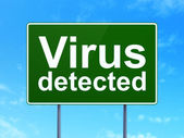 Privacy concept: Virus Detected on road sign background — Стоковое фото