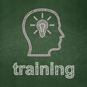 Education concept: Head With Lightbulb and Training on chalkboard background — Stock Photo