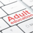 Education concept: Adult Education on computer keyboard background — Stock Photo #37501195