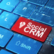 Finance concept: Light Bulb and Social CRM on computer keyboard background — Stock Photo #37503951