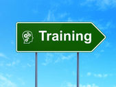Education concept: Training and Head With Gears on road sign background — Stock Photo