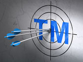 Law concept: arrows in Trademark target on wall background — Foto Stock