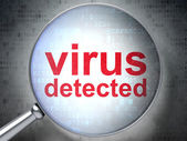 Safety concept: Virus Detected with optical glass — Stock Photo