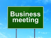 Finance concept: Business Meeting on road sign background — Stock Photo