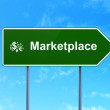 Advertising concept: Marketplace and Finance Symbol on road sign background — Stock Photo