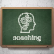 Education concept: Head With Gears and Coaching on chalkboard background — Stock Photo