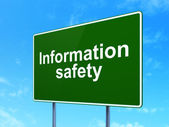 Protection concept: Information Safety on road sign background — Stockfoto