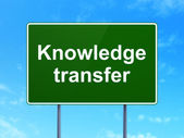 Education concept: Knowledge Transfer on road sign background — Stock Photo