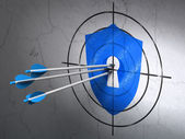 Safety concept: arrows in Shield With Keyhole target on wall background — Stockfoto