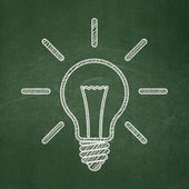 Business concept: Light Bulb on chalkboard background — Foto Stock