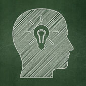 Education concept: Head With Light Bulb on chalkboard background — Stock Photo