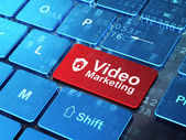 Business concept: Shield and Video Marketing on computer keyboard background — Stok fotoğraf