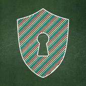 Privacy concept: Shield With Keyhole on chalkboard background — Stock Photo