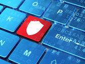 Safety concept: Shield on computer keyboard background — Stok fotoğraf