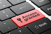 Safety concept: Key and Access Granted on computer keyboard background — Stock Photo