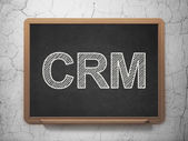 Business concept: CRM on chalkboard background — Stock Photo