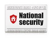 концепция безопасности: газета с национальной безопасности и щит — Стоковое фото