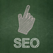 Web development concept: Mouse Cursor and SEO on chalkboard background — Stock Photo