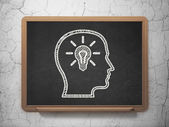 Education concept: Head With Lightbulb on chalkboard background — Stock Photo