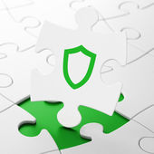 Security concept: Contoured Shield on puzzle background — Stock Photo